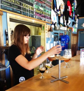Lindsy pours a taster at the Ballast Point Tap Room