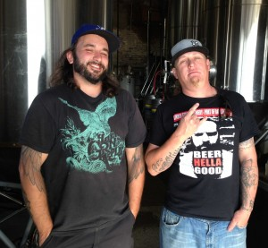 """Head Brewer of Linden St Kel - gives us """"the fingers"""" in front of the fermentors"""