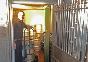 Jason pulls a fresh keg out of the vault - at the Vault
